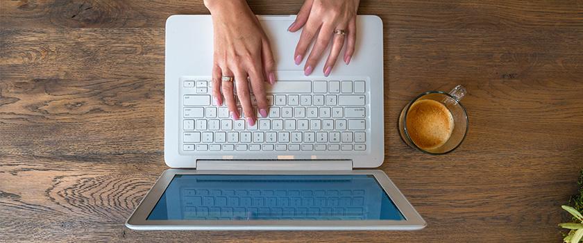 Woman using laptop computer.
