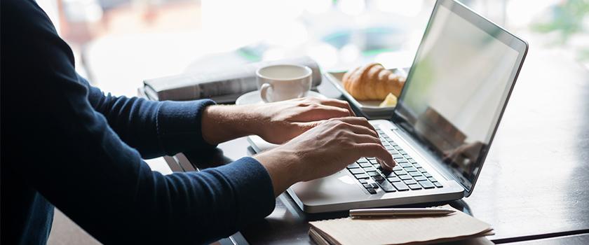 Man using a laptop computer.