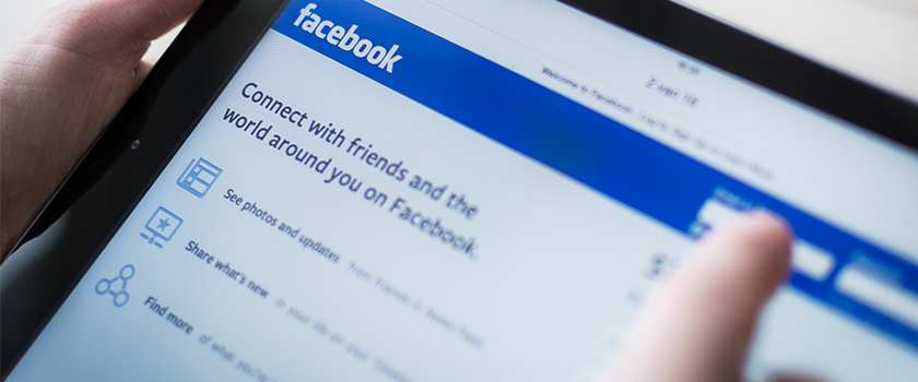 Person logging into Facebook.