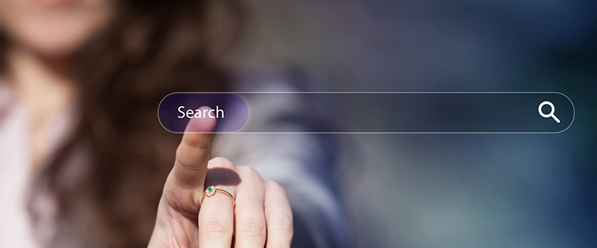 Woman clicking the search button on a search engine webpage.