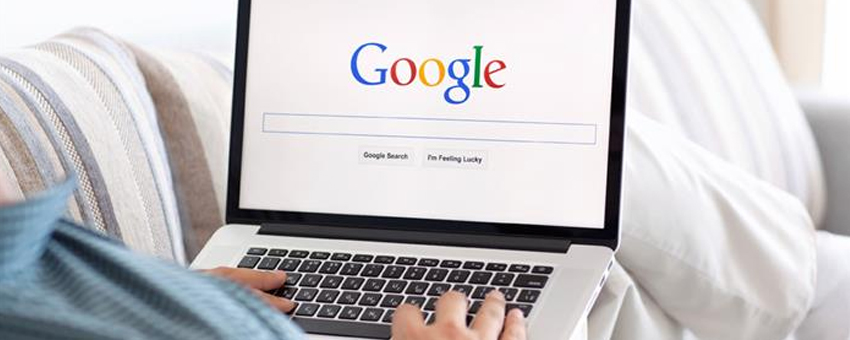 Person browsing on Google on their laptop.