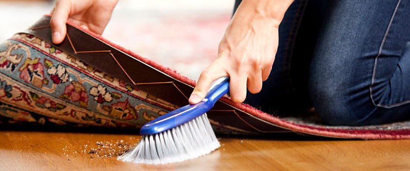 Brushing dirt under the carpet symbolizing what most people do to deal with a negative review